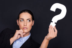 Businesswoman holding a question mark Royalty Free Stock Photos