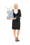 Businesswoman holding a recycle bin Royalty Free Stock Image
