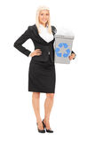 Businesswoman holding a recycle bin Stock Photos