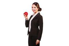 Businesswoman holding a red apple in hands Royalty Free Stock Photo