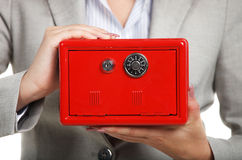 Businesswoman holding red safe in her hands Stock Photo