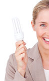 Businesswoman holding a saving energy light bulb Royalty Free Stock Photo