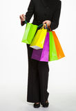 Businesswoman holding several paper bags Royalty Free Stock Image