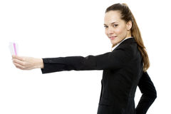 Businesswoman holding sheets of paper Royalty Free Stock Photos