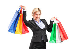 Businesswoman holding shopping bags Royalty Free Stock Photos