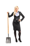 Businesswoman holding a shovel Royalty Free Stock Photos