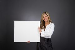 businesswoman holding sign Royalty Free Stock Images