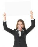 Businesswoman holding sign excited Royalty Free Stock Photos