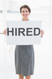 Businesswoman holding sign in front of her Royalty Free Stock Photos