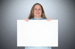 Businesswoman holding a sign with no text in her hand Stock Images