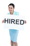 Businesswoman holding a signboard hired Stock Image