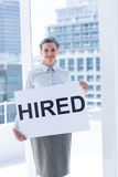 Businesswoman holding a signboard hired Royalty Free Stock Photos