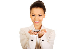 Businesswoman holding small car on palm. Royalty Free Stock Photos