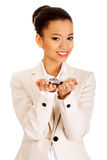Businesswoman holding small car on palm. Royalty Free Stock Photography