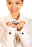 Businesswoman holding small car on palm. stock photography
