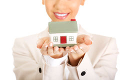 Businesswoman holding small house on palm. Royalty Free Stock Photo