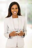 Businesswoman holding smart phone Royalty Free Stock Photo