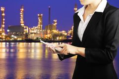 Businesswoman holding smart phone for industry energy business c Royalty Free Stock Photos