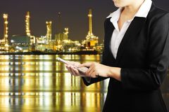 Businesswoman holding smart phone for industry energy business c Stock Images