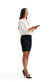 Businesswoman holding smartphone Royalty Free Stock Images