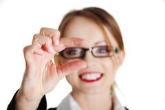 Businesswoman holding something Stock Images