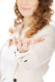 Businesswoman holding something on her hand. Royalty Free Stock Images