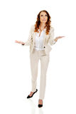 Businesswoman holding something on her hands. Royalty Free Stock Photography