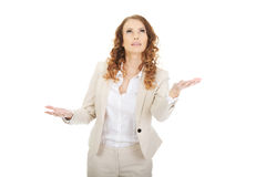 Businesswoman holding something on her hands. Businesswoman with empty palms holding something Stock Photo