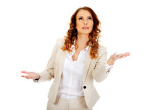 Businesswoman holding something on her hands. Businesswoman with empty palms holding something Stock Image