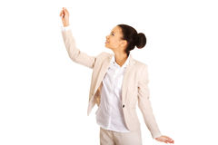 Businesswoman holding something high. Royalty Free Stock Photos