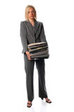 Businesswoman Holding Stack of Paperwork Stock Images