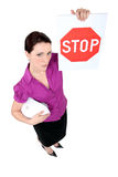 Businesswoman holding stop sign Stock Photo