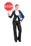 Businesswoman holding a stop sign Royalty Free Stock Images