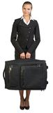 Businesswoman holding suitcase, looking at camera Stock Image