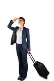Businesswoman holding suitcase and looking Stock Images
