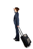 Businesswoman holding suitcase and looking Stock Image