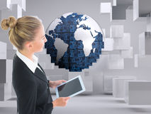 Businesswoman holding tablet. Composite image of blonde businesswoman holding tablet Stock Image
