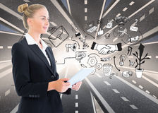 Businesswoman holding tablet. Composite image of blonde businesswoman holding tablet royalty free stock image