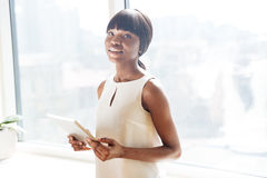 Businesswoman holding tablet compute Stock Images