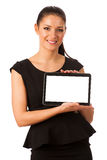 Businesswoman holding tablet computer and showing blank monitor Stock Images