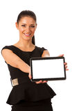 Businesswoman holding tablet computer and showing blank monitor Stock Photography