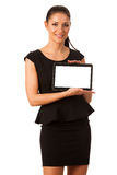 Businesswoman holding tablet computer and showing blank monitor Royalty Free Stock Photo