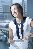 Businesswoman holding tablet device and smiling Royalty Free Stock Photos
