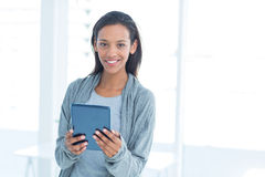 Businesswoman holding a tablet in the office Royalty Free Stock Image