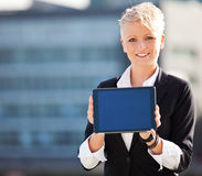 Businesswoman holding tablet pc Royalty Free Stock Images