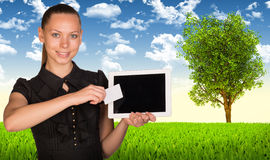 Businesswoman holding tablet PC and business card Stock Photos
