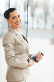 Businesswoman holding tablet stock photography