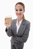 A businesswoman holding a takeaway coffee Royalty Free Stock Image
