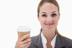 Businesswoman holding a takeaway coffee Royalty Free Stock Images