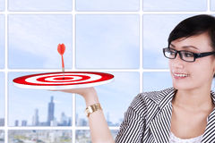 Businesswoman holding a target Royalty Free Stock Image